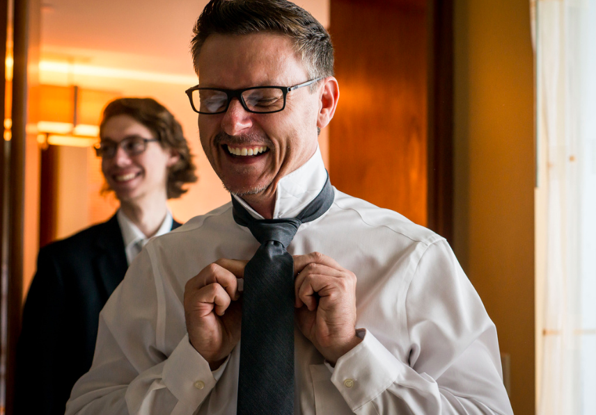 groom wearing tie